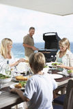 Family Enjoying A Barbecue Stock Image