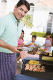 Family Enjoying A Barbeque stock images