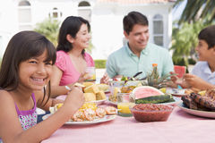Family Enjoying A Barbeque Royalty Free Stock Image