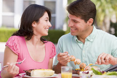 Family Enjoying A Barbeque. Smiling stock photo