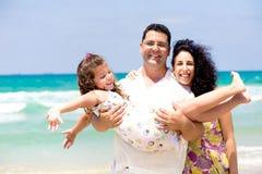 Family enjoying on the beach Royalty Free Stock Photo