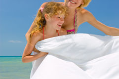 Family enjoying beach lifestyle Royalty Free Stock Images
