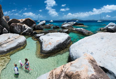 Family enjoying beach view. Family of mother and kids at The Baths beach area major tourist attraction at Virgin Gorda, British Virgin Islands, Caribbean Stock Images