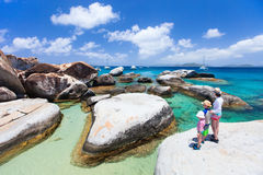 Family enjoying beach view. Family of mother and kids enjoying view of beautiful scenery of The Baths beach area major tourist attraction at Virgin Gorda Stock Image