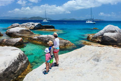 Family enjoying beach view. Family of mother and kids enjoying view of beautiful scenery of The Baths beach area major tourist attraction at Virgin Gorda Stock Photography