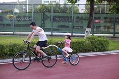 Family enjoying a bike ride Stock Images