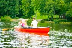 Family Enjoying A Boat Trip stock photography
