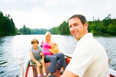 Family Enjoying A Boat Trip stock images