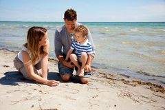 Family Enjoying Bonding Time on the Beach Stock Photos