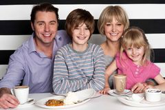 Family enjoying breakfast at restaurant Royalty Free Stock Photography