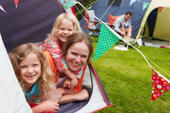 Family Enjoying Camping Holiday On Campsite. Smiling royalty free stock images