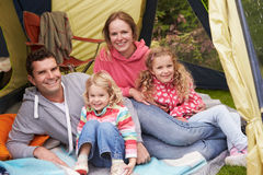 Family Enjoying Camping Holiday On Campsite stock photography