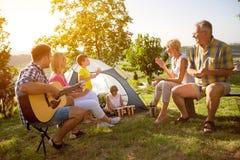 Family enjoying camping holiday stock image