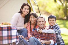 Family Enjoying Camping Holiday In Countryside. Smiling To Camera royalty free stock photography