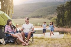 Family Enjoying Camping Vacation By Lake Together royalty free stock images