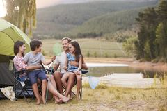 Family Enjoying Camping Vacation By Lake Together stock images