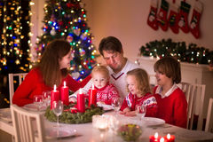 Family enjoying Christmas dinner at home Stock Images
