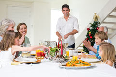 Family enjoying Christmas meal at dining table Stock Image