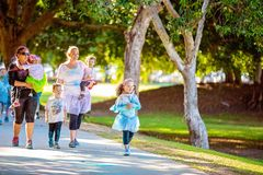 Family Enjoying Color Frenzy Fun Run. MACKAY, QUEENSLAND, AUSTRALIA - JUNE 2019: Unidentified children and women enjoy participating in Color Frenzy Fun Run stock images