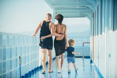 Family enjoying a cruise vacation together in summer.