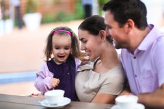 Family enjoying cup of coffee In cafe together Stock Images