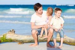 Family enjoying evening by the sea Royalty Free Stock Photo