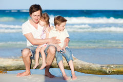 Family enjoying evening by the sea Stock Photography
