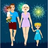 Family enjoying firework display on summer holiday night Royalty Free Stock Photography