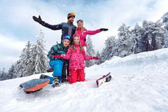Family enjoying and having fun on winter vacation together on th stock images