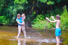 Family enjoying hot day on a river Royalty Free Stock Photography