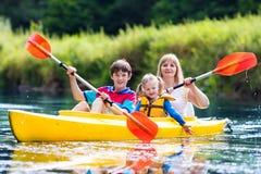 Free Family Enjoying Kayak Ride On A River Stock Images - 75600384