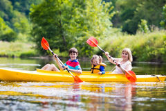 Free Family Enjoying Kayak Ride On A River Stock Images - 84951704
