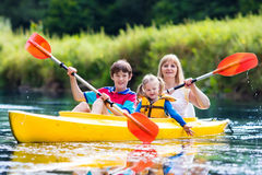 Family enjoying kayak ride on a river Stock Images