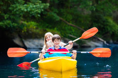 Family enjoying kayak ride on a river Royalty Free Stock Images