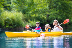 Family enjoying kayak ride on a river Stock Photos