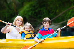 Family enjoying kayak ride on a river Royalty Free Stock Photos