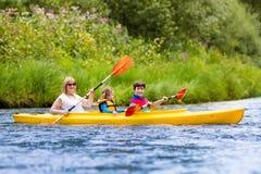 Family enjoying kayak ride on a river Royalty Free Stock Photos
