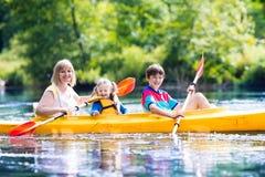 Family enjoying kayak ride on a river Royalty Free Stock Image