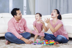 Family enjoying leisure time in the living room Royalty Free Stock Photo