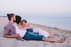 Family enjoying life on the beach Royalty Free Stock Photo