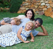 Family enjoying life in the garden Royalty Free Stock Images