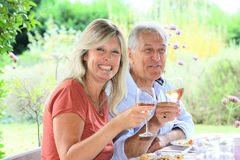 Family enjoying lunch in terrace Royalty Free Stock Photos
