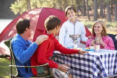 Family Enjoying Meal On Camping Holiday Royalty Free Stock Photos