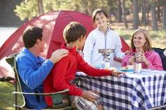 Family Enjoying Meal On Camping Holiday Royalty Free Stock Photos