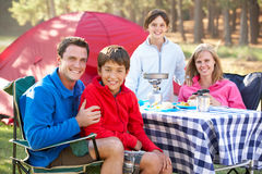 Family Enjoying Meal On Camping Holiday Royalty Free Stock Photography