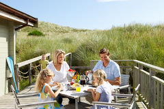 Family enjoying a meal on the deck Royalty Free Stock Image