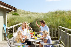 Family enjoying a meal on the deck. Of their chalet Royalty Free Stock Image