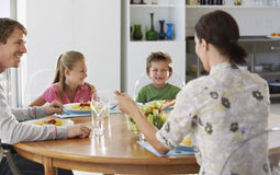 Family Enjoying Meal At Dining Table Stock Photos