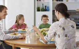 Family Enjoying Meal At Dining Table Stock Photos