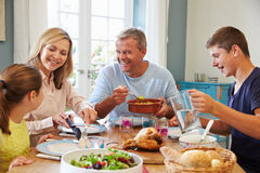 Family Enjoying Meal At Home Together Royalty Free Stock Images